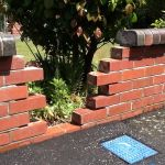 Repair of a Red Brick Fence