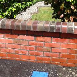 Repair of a red brick wall