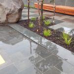 Outdoor commercial paving area, glossy pavers