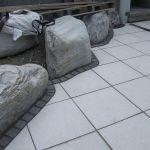 Tricky paved edging around large rocks