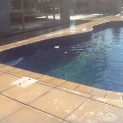Paved area around pool with border
